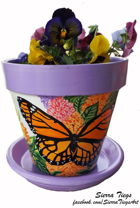 Hand painted flower pot with monarch butterflies and butterfly flowers.