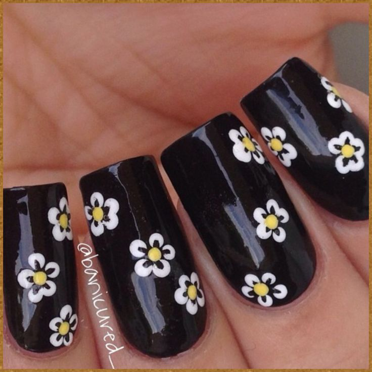 """Daisy Chain Nail Art— You can do this as a chain like I did or just as individual daisies. I'm using acrylic paint, along with a dotting tool and brush, both from @colorclubnaillacquer. Music is """"Little Secrets"""" by Passion Pit #banicured daisy chain inspired by @wahnails!"""