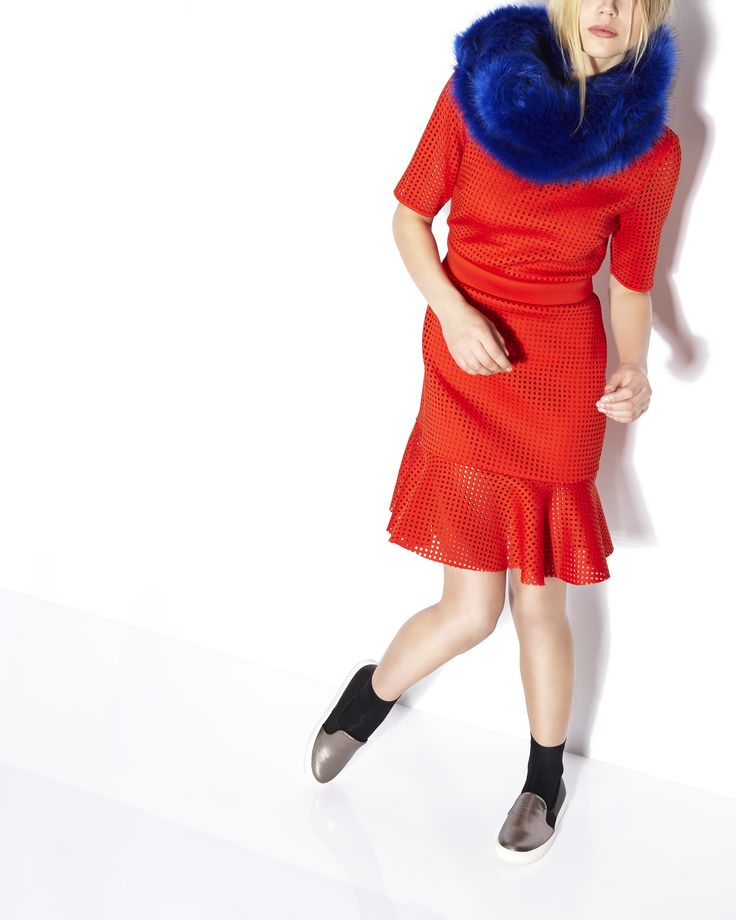 Reinvigorate your style with Savida's electric blue faux-fur scarf and fitted mesh dress in an eye-catching orange hue