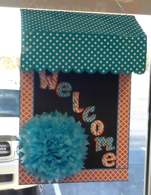 Welcome bulletin board with an adorable teal polka dot awning