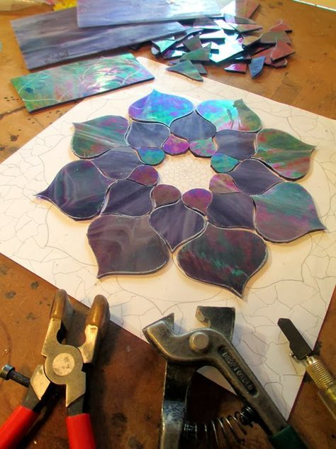 Below is a series of flowers that I've created as stained glass mosaics. All of the designs were hand drawn by me for this specific project...