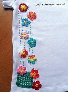 crochet motifs on a onesy or t-shirt.