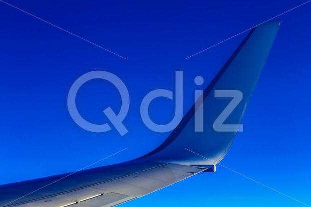 Qdiz Stock Images Plane Wing on Sky Background
