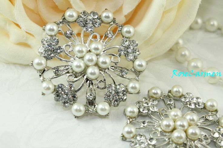 BOUQUET Beautiful Silver tone Pearl and Sparkling rhinestone brooch embellishment.    These pieces are Flat back, can easily be glued with some good quality jewelry glue such as E6000. Lots of SPARKLE! Sparkling Clear Glass Crystal rhinestones and Silver tone faux pearls .    Very Elegant !    Size: Approx: 50mm - 2 inches    Can be used for Bridal Bouquet ,Ring bearer pillow, bridal Sash,Bridesmaid Sash, Wedding Cake, or add it to hair comb, shoe clip, bridal garter.    Listing is for 2…