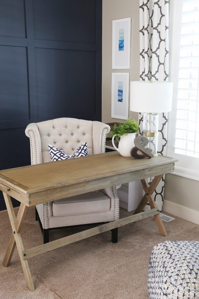 Office with wood desk, Hale Navy walls, and green and white accents