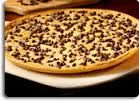 Pizza Inn's Chocolate Chip Pizza Recipe – baking pan, approximately 10×15 inches –  1 THIN pizza crust in a can –  2 sticks of butter, melted –  1 box of yellow cake mix –  1 bag of chocolate chips –  1/4 cup brown sugar –  1/4 cup granulated sugar