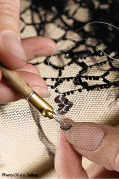 Hand-beaded embellishments being crafted for a haute couture dress - fashion atelier; fashion design behind the scenes // Lesage