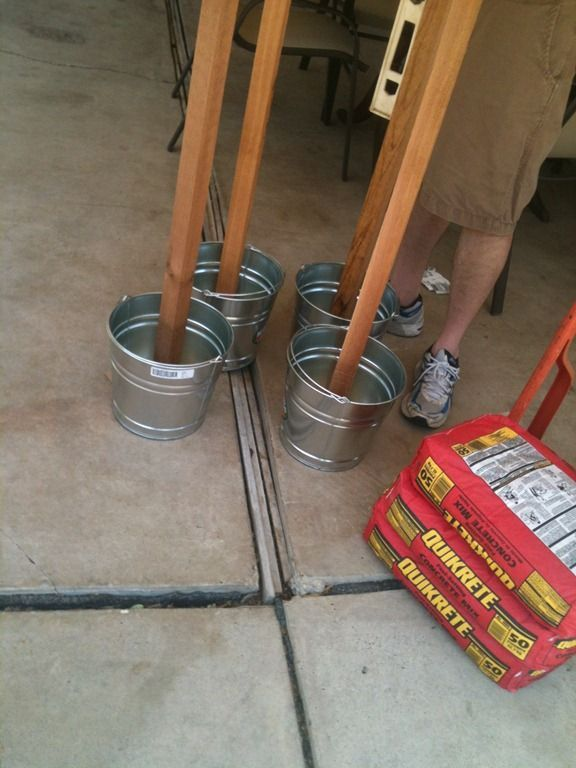 Set your light posts, tiki torches, etc in a bucket of concrete so they don't blow over. Great idea.