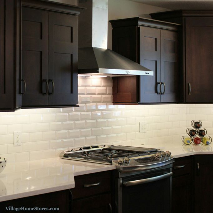 Stainless Steel chimney style range hood surrounded by