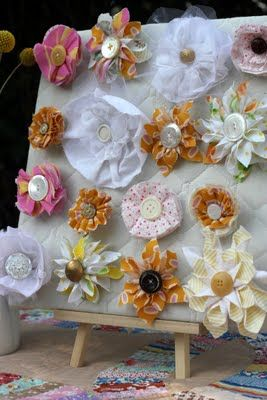 """baby shower favors - """"To celebrate the little bloom"""".  These flowers are ugly, but the I love the idea of handmade flower hair clips as favors!"""