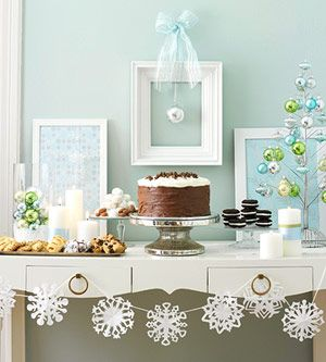 Paper Snowflake Chain: Decorate a mantel or a buffet table with this icy snowflake chain. Simply cut snowflakes from paper and string them together with white ribbon or string. To make the snowflakes stay in place, add a drop of glue to the ribbon.