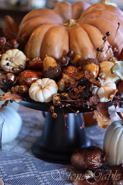 fall centerpiece - assorted nuts, acorns, berries, gourds - center around pumpkin - use pedestal vase/complote