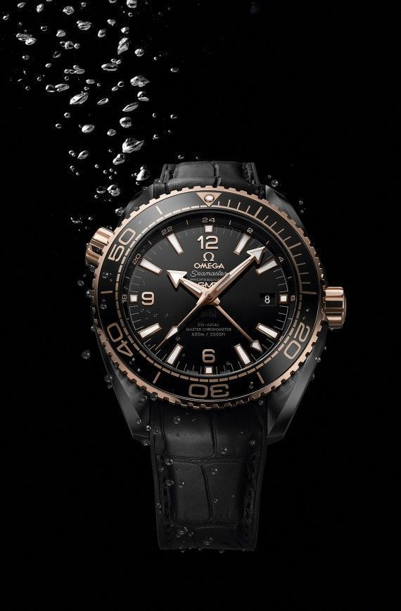 The Omega Seamaster Planet Ocean (Sedna Gold model) features its bezel, crowns, hands and indices forged from Omega's own 18k Sedna gold.  It is fitted with Omega's Master Chronometer Caliber 8906, which boasts resistance to magnetic fields of 15,000 gauss. More @ http://www.watchtime.com/wristwatch-industry-news/watches/showing-at-watchtime-new-york-2016-omega-seamaster-planet-ocean-deep-black-collection/ #omega #watchtime #divewatch