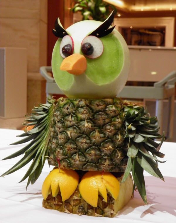 An owl made of pineapple, melon, orange peel feet, and a few other veggies. It was created to be a display for a cruise ship.