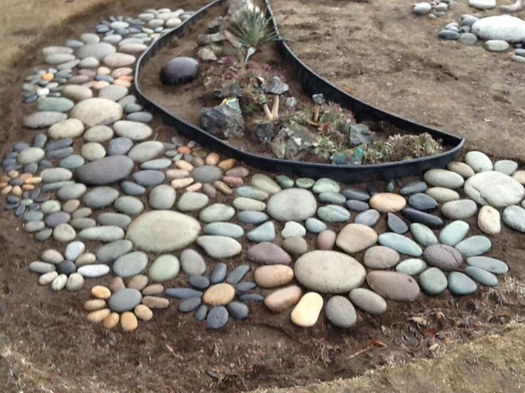 River rock flowers! Spray rocks with gloss to keep…