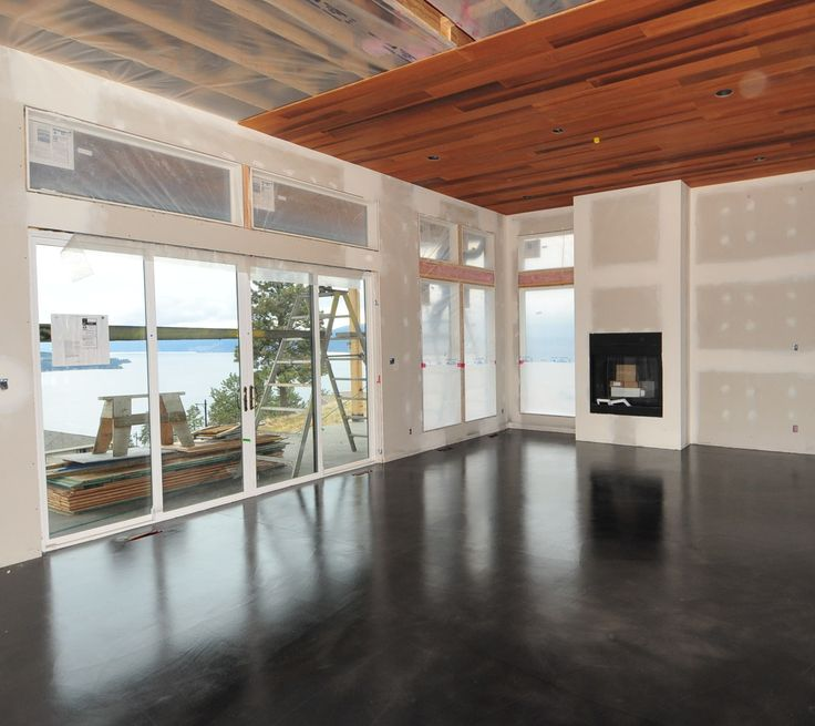 A modern black stained concrete floor created by mode for Hardwood floors kelowna