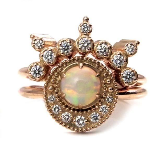 Diamond and Opal Shooting Star Celestial Engagement Ring Set - 14k Rose GoldThis celestial engagement ring is set with a gorgeous 6mm opal in the center, it weighs approximately .50 carats. Below the opal is a crescent moon of tiny diamonds. They are VS clarity and G-H in color and weigh approx. .08 carats. The star burst side band is set with an additional approx. .18 carats of VS clarity G-H color diamonds.  here in 14k rose gold, it can also be made in yellow or palladium