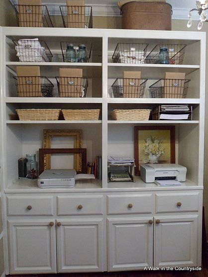 Cabinets repurposed to office storage.