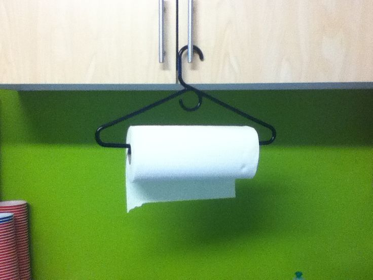 Use a hanger as a paper towel holder