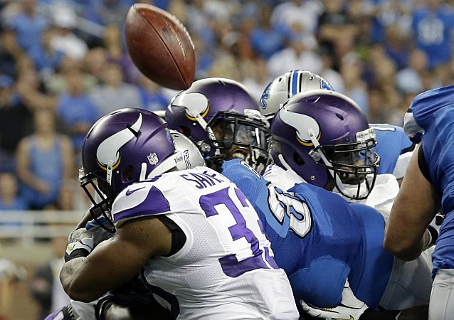 Detroit Lions running back Joique Bell, center in blue, loses control of the ball after crossing the goal line during the second quarter of an NFL football game against the Minnesota Vikings at Ford Field in Detroit, Sunday, Sept. 8, 2013. (AP Photo/Paul Sancya) Lions beat Vikings 34-24