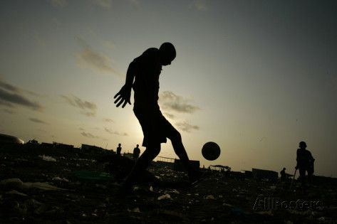 Angolan Youths Play Soccer in the Streets of the Capital Luanda Photographic Print by Rafael Marchante at AllPosters.com