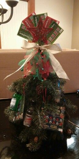 Yankee swap booze tree. Bottle of wine covered 4 fake pine branches, 6 nips and lottery tickets.