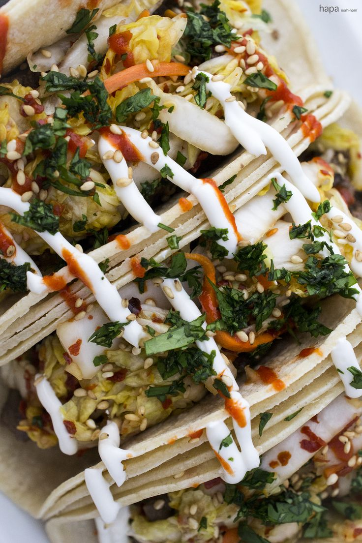 A full flavor experience - these Korean Tacos with umami rich beef, spicy kimchi, cool sour cream, and smoky Sriracha, will have you craving this dish constantly!!!