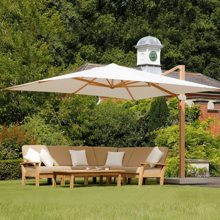 The Barlow Tyrie Napoli 13' Square Cantilever Umbrella provides portable shade to a large outdoor seating or dining area.