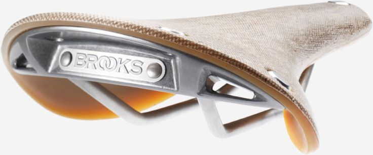 CAMBIUM saddle by Brooks, England. Made from vulcanized natural rubber and organic cotton canvas enhanced by a thin layer of structural textile for added resilience and legendary Brooks longevity. The uniquely flexible, maintenance-free, waterproof top is designed to follow the rider's movements to deliver immediate comfort and ease of use.