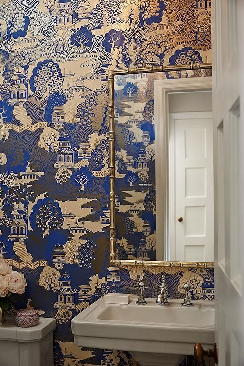 Chinoiserie powder room features walls clad in Osborne