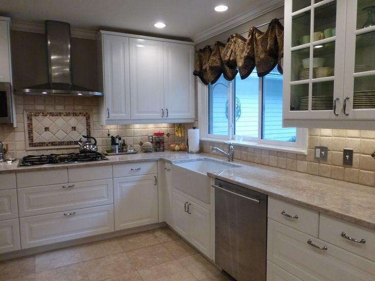 White Cabinets With Taj Mahal Quartzite By Us Kitchens