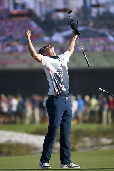 Justin Rose of Great Britain celebrates victory on the 18th green after the…