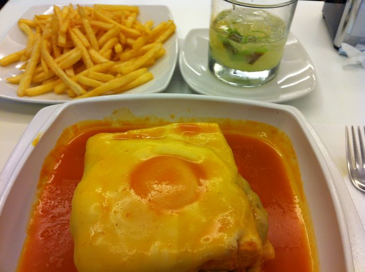 """In Porto, Portugal, a must-try dish is the """"Francesinha"""" which is a sandwich with layers of meat (beef, pork meat or ham) covered with cheese and a spicy sauce. It is considered to be one of the 10 best sandwiches in the world."""