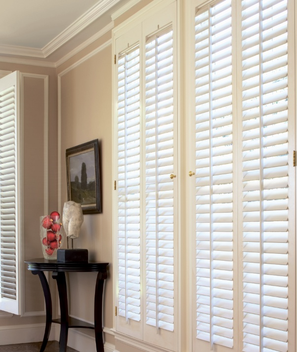 Basswood Plantation Shutters With 2 Louvers In Eggshell Painted Finish With  Brass Hinges