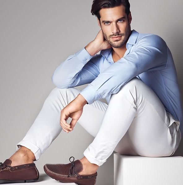 Shop this look on Lookastic: http://lookastic.com/men/looks/light-blue-long-sleeve-shirt-white-chinos-dark-brown-leather-driving-shoes/11231 — Light Blue Long Sleeve Shirt — White Chinos — Dark Brown Leather Driving Shoes