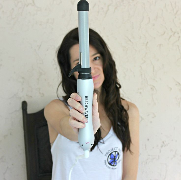 The coolest rotating curling iron for fall waves... it curls your hair for you!
