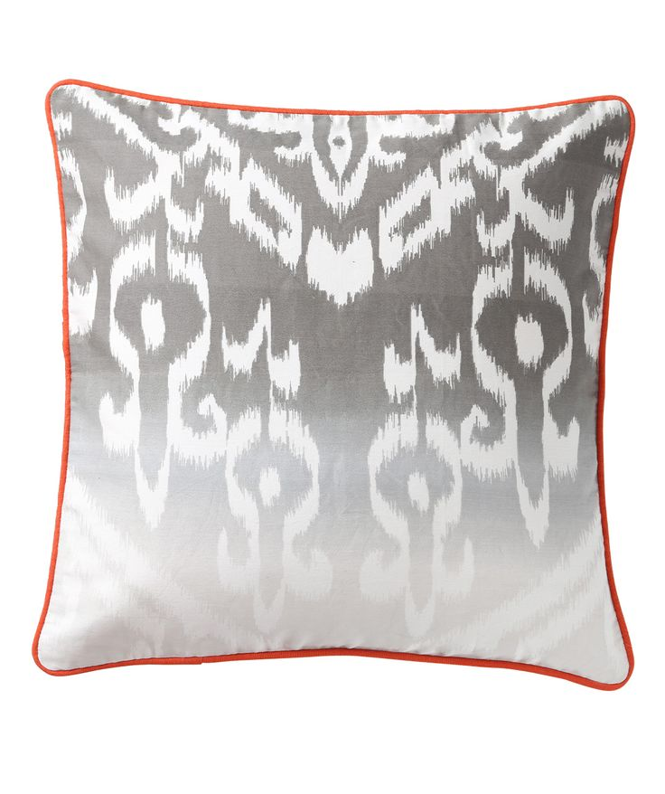 Flaming Ikat has been modified into all sorts of patterns lately. We bring to you a digital printed traditional Ikat pattern with a contrast coloured piping. The neutral gray coloured fabric with pop orange coloured piping perfectly balances this design. www.theindianpick.com