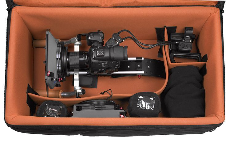"PortaBrace's wheeled camera case with interior kit, RIG-4SRKOR. At 10.50lb (4.76kg) it's interior measures: 29.5"" x 15.5"" x 13.5"" (74.93 x 39.37 x 34.29cm). It's not cheap $554.65 but does look more subtle than one of Pelican's space, travel, safari cases."