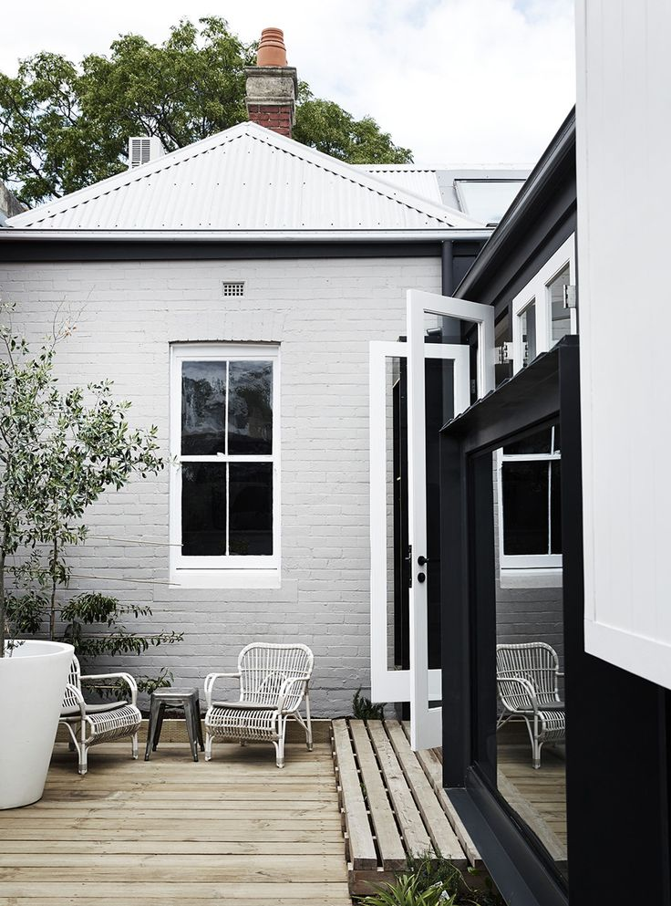 Painted brick with weatherboard