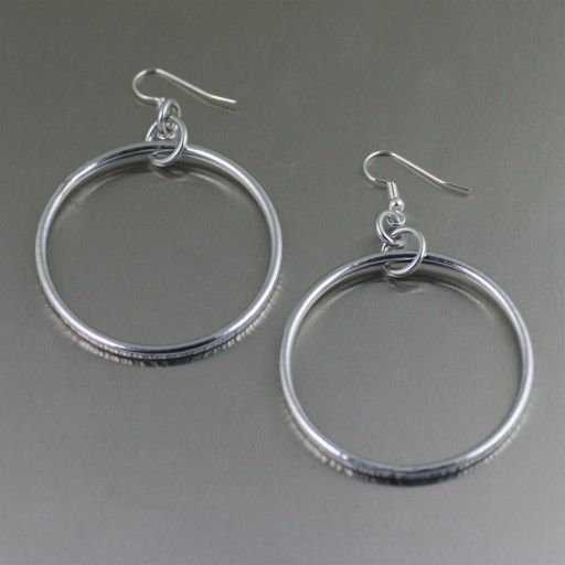 Add the finishing touch to almost any of your ensembles with this pair of highly polished Chased Aluminum Rim Hoop Earrings. From work to weekend, these aluminum earrings with their chased rims exerts an elegant influence making them the perfect everyday accessory.