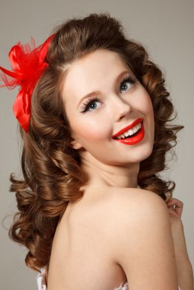 Curly long hairstyle. I agree that this is a classic retro pin-up style.  Cute and pretty.  Search results you may like. Retro styles: http://shopads.whw1.com/?q=retro%20hairstyles   ***** Referenced by Web Hosting With A Dollar (WHW1.com): When you want website hosting, go to the best, WHW1.com. Website Hosting that is Affordable, Reliable, Fast, Easy, Advanced, and Complete.©