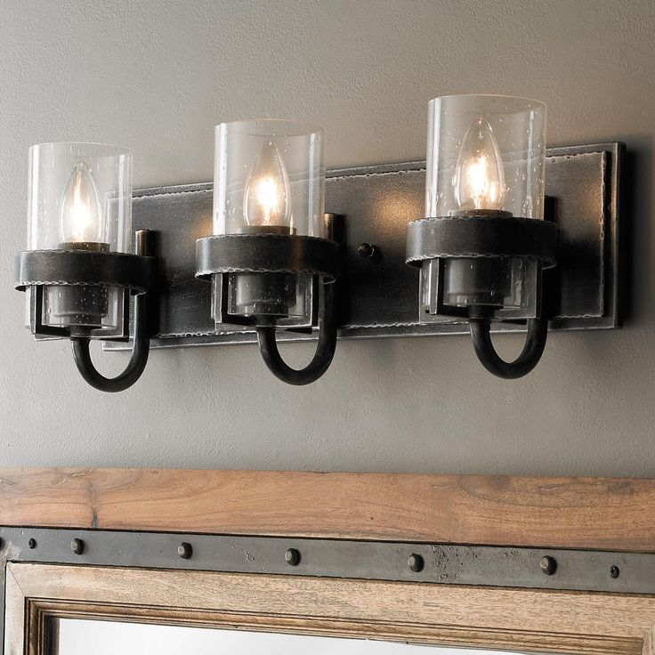 Factory Vintage Iron Bath Light - 3 Light Reminiscent of a vintage factory sconce this industrial sconce in vintage iron is a perfect transitional piece to your decor. Available in a sconce, 2-light bath, 3-light bath, or 4-light bath light.