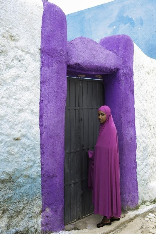 Harar, Ethiopia reminds me of the color purple     PERHAPS THIS SWATCH  ON THE DOOR HELPS MAKE LIFE LESS DISMAL.....BUT REALLY WHO ARE WE TO SAY THEY ARE NOT COMPLETELY HAPPY WITH THEIR LIFE.....WE SHOULD NOT SURMISE.....ccp