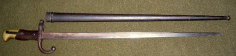 "Bayonet, French, Marked with three unintelligible marks on hook tang, RS6546, on 25 1/2"" blade w 5"" handle of wood and brass. Has  21"" metal sheath.  Serial number? Blade has steel ""T"" stiffener. marked Usine de Steyr 1840."