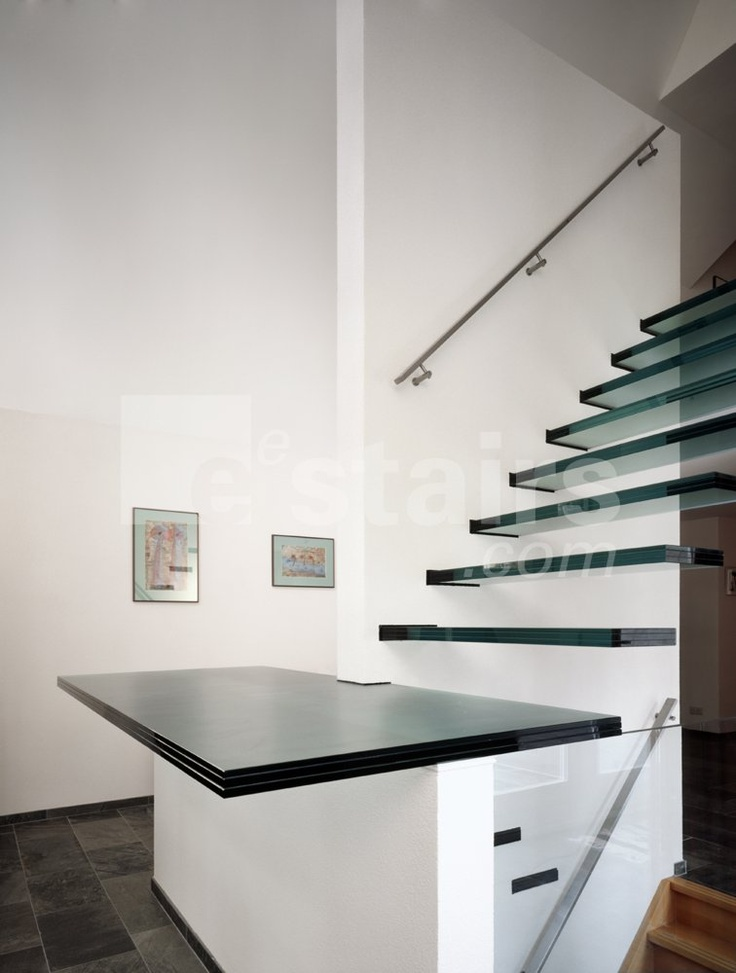 Floating Staircase Featuring Glass Treads Manufactured By EeStairs.