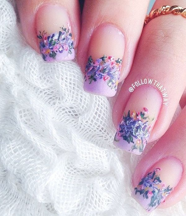 Flower inspired French tip spring nail art design. The flowers are in periwinkle theme and are crowning the French tips making your nails look really pretty and cute.