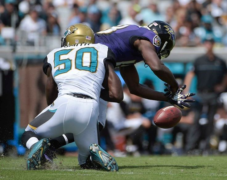 Jacksonville Jaguars outside linebacker Telvin Smith (50) breaks up a pass intended for Baltimore Ravens wide receiver Breshad Perriman during the first half of an NFL football game in Jacksonville, Fla., Sunday, Sept. 25, 2016.