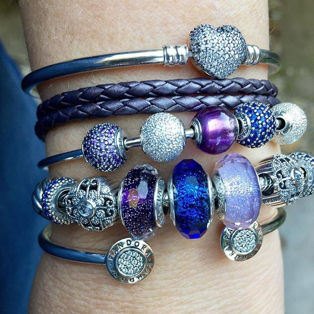 """In the mood for shimmer and Poetic Blooms. Essence """"Peace"""" bead seems right today!  #pandorabracelets #pandoraaddict #signaturebangle #silverbracelets #uniqueasyouare #myarmparty #poeticblooms #purple #leather for bracelet twin today @trolli_mutz #officialpandora #theofficialpandora @theofficialpandora"""