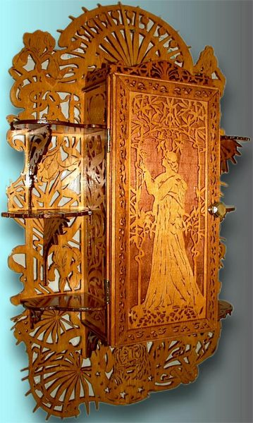 This is an alluring art nouveau wall cabinet. The cabinet is in the center and three shelves on each side complete the design. Its ornamentation is fully in Art Nouveau style.