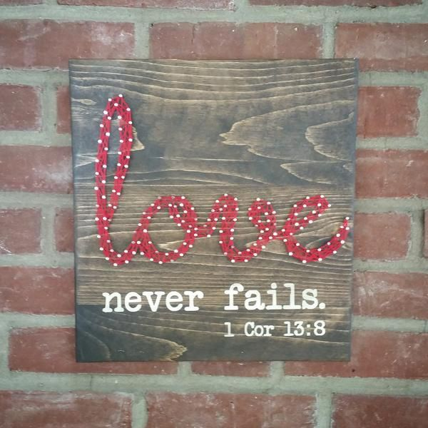 "Love never fails string art is approx. 12"" x 13"" Made from reclaimed wood, nails, chalk paint and embroidery thread."